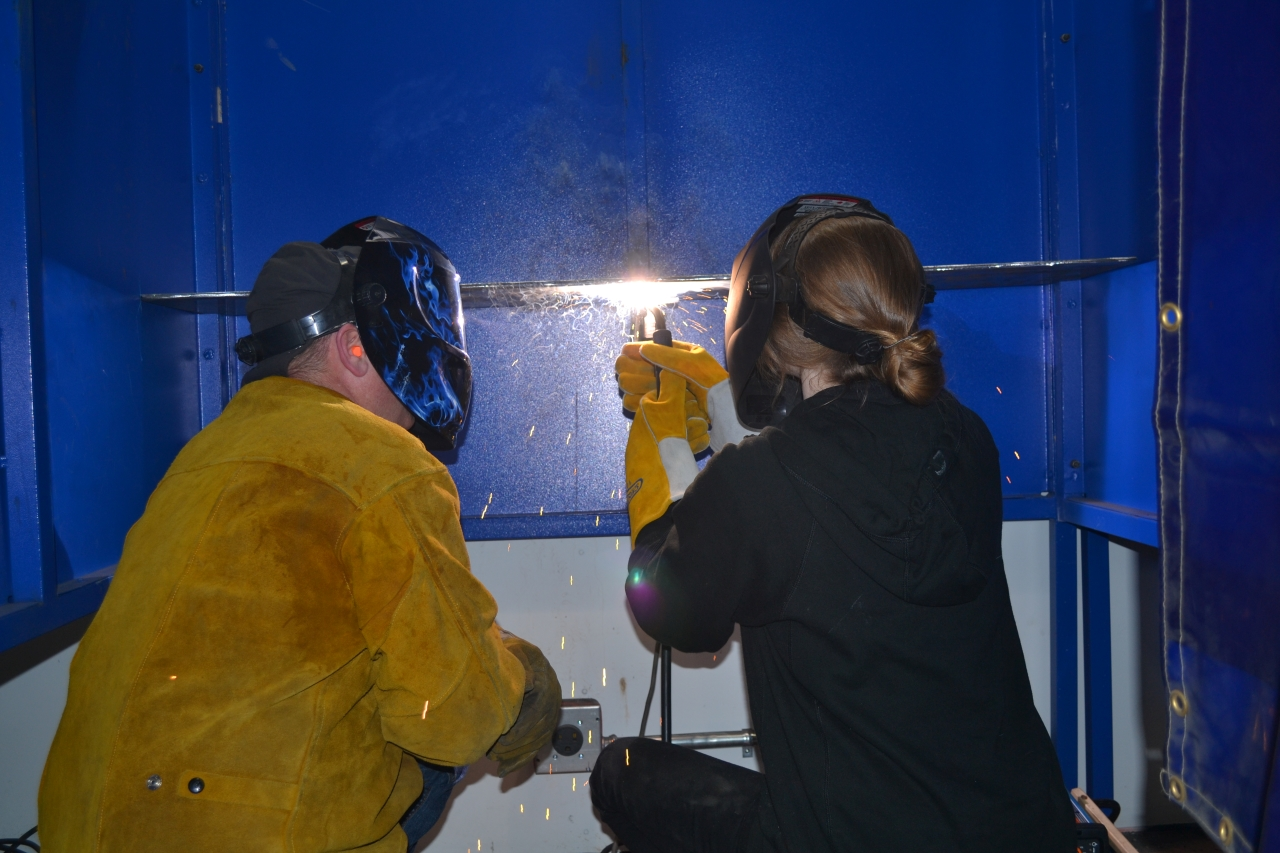 instructor and student welding