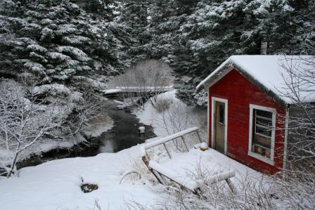snow and red cabin