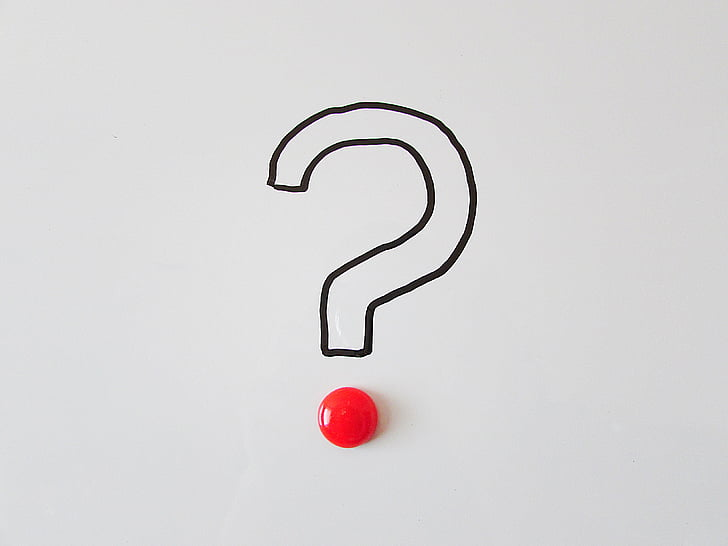 question mark with a red button for the dot